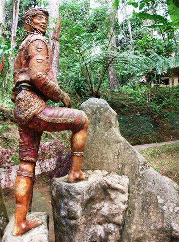 sentinel at the entrance of a native village recreated in Park Eden