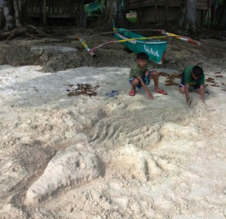 Enough sand to make a life-sized beach alligator!
